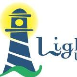 Lighthouse By The Bay RV Park logo